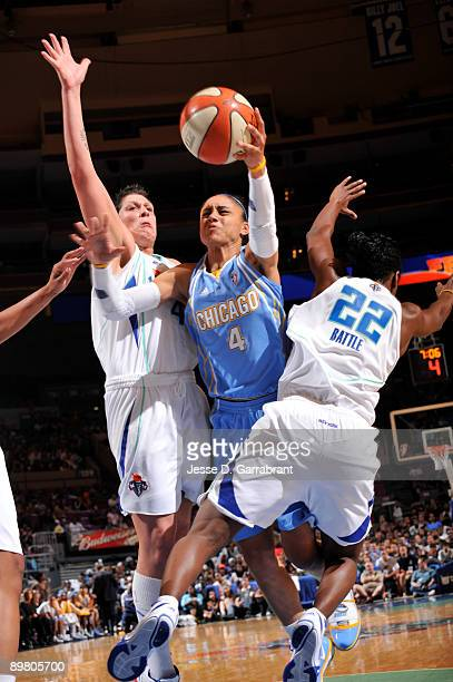 Candice Dupree of the Chicago Sky goes up for a shot against Janel McCarville of the New York Liberty on August 14, 2009 at Madison Square Garden in...