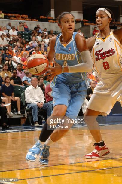 Candice Dupree of the Chicago Sky moves past Tammy SuttonBrown of the Indiana Fever at Conseco Fieldhouse July 8 2007 in Indianapolis Indiana NOTE TO...