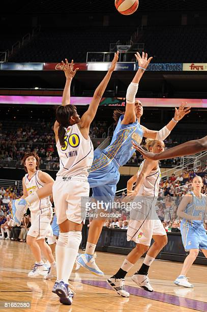 Candice Dupree of the Chicago Sky shoots against Tangela Smith of the Phoenix Mercury on June 20 at U.S. Airways Center in Phoenix, Arizona. NOTE TO...