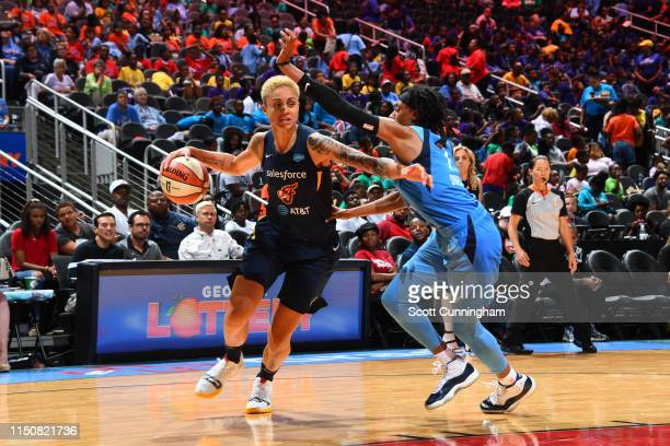 Candice Dupree of the Indiana Fever handles the ball against the Atlanta Dream on June 19, 2019 at the State Farm Arena in Atlanta, Georgia. NOTE TO...