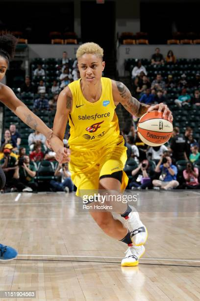 Candice Dupree of the Indiana Fever handles the ball against the Minnesota Lynx on June 25, 2019 at Bankers Life Fieldhouse in Indianapolis, Indiana....