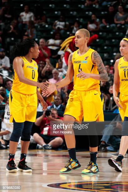 Candice Dupree of the Indiana Fever high fives Kelsey Mitchell of the Indiana Fever on June 16 2018 at Bankers Life Fieldhouse in Indianapolis...