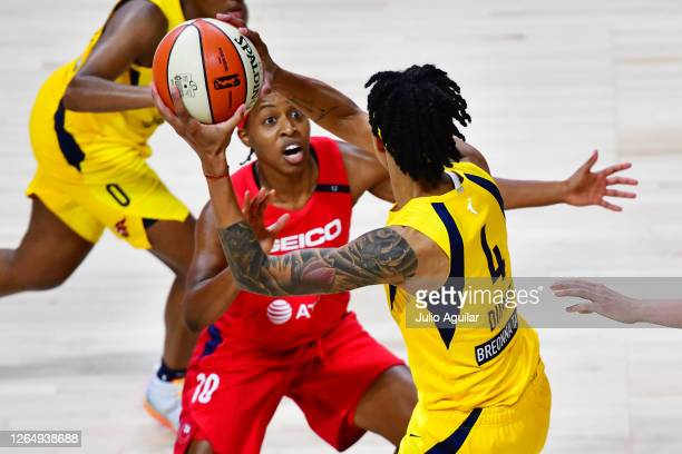 Candice Dupree of the Indiana Fever looks to pass the ball against Shey Peddy of the Washington Mystics during the second half of a game at Feld...