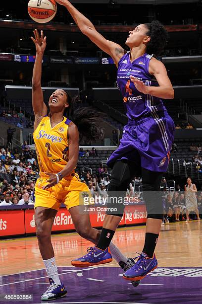 Candice Dupree of the Phoenix Mercury blocks a shot against Candice Wiggins of the Los Angeles Sparks in Game Two of the WNBA Conference Semifinals...