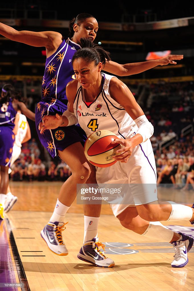 Candice Dupree #4 of the Phoenix Mercury drives against Tina Thompson #32 of the Los Angeles Sparks in an WNBA game played on June 8, 2010 at U.S. Airways Center in Phoenix, Arizona.