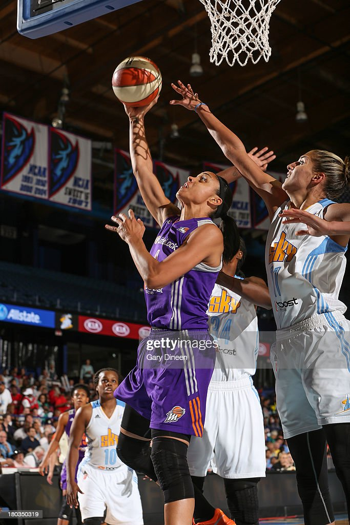 Candice Dupree #4 of the Phoenix Mercury shoots against Elena Delle Donne #11 of the Chicago Sky during the game on September 11, 2013 at the Allstate Arena in Rosemont, Illinois.