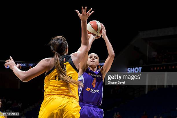 Candice Dupree of the Phoenix Mercury shoots against Elizabeth Cambage of the Tulsa Shock during the WNBA game on August 20 2013 at the BOK Center in...