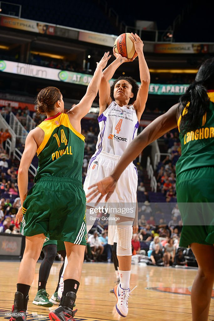 Candice Dupree #4 of the Phoenix Mercury shoots against Nicole Powell #14 of the Seattle Storm on June 3, 2014 at US Airways Center in Phoenix, Arizona.