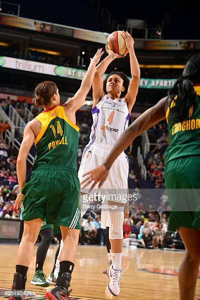 Candice Dupree of the Phoenix Mercury shoots against Nicole Powell of the Seattle Storm on June 3 2014 at US Airways Center in Phoenix Arizona NOTE...