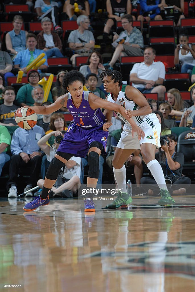 Candice Dupree #4 of the Phoenix Suns posts up against the Seattle Storm during the game on August 17, 2014 at Key Arena in Seattle, Washington.