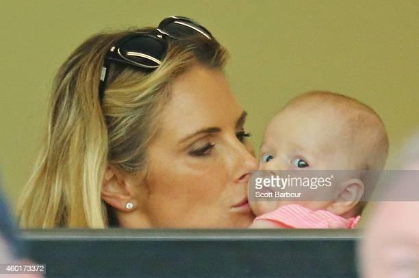 Candice Falzon Australian Professional Ironwoman and fiancee of David Warner of Australia kisses their daughter Ivy as David Warner of Australia...