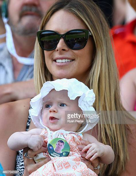 Candice Falzon Professional Ironwoman and fiance of David Warner of Australia holds their baby daughter Ivy during day four of the 2nd Test match...