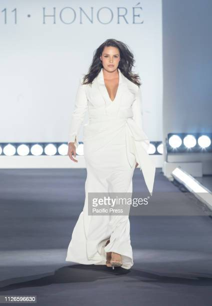 Candice Huffine wearing dress by Christian Siriano walks runway for 11 Honore fashion show during Fall/Winter New York Fashion Week at Spring Studios.