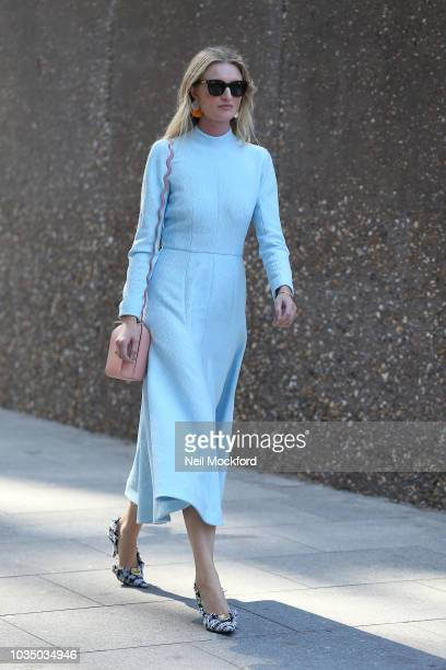 Candice Lake is seen wearing a blue long sleeve midi dress and a nude pink wavy strap bag outside Christopher Kane at Tate Modern during London...