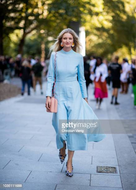 Candice Lake wearing blue dress is seen outside Christopher Kane during London Fashion Week September 2018 on September 17 2018 in London England