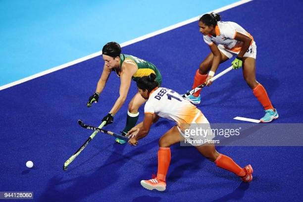 Candice Manuel of South Africa competes for the ball with Deepika of India during the Women's Pool A match between South Africa and India on day six...