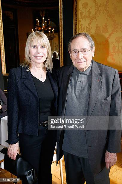 Candice Patou and Robert Hossein attend Levon Sayan receives Insignia of Commandeur de l'Ordre National du Merite at Hotel d'Evreux on June 14 2016...