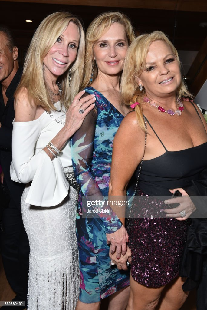 Candice Stark, Linda Argila and Amelia Doggwiler attend ARTrageous Gala + Art Auction benefitting Hour Children at a Private Residence on August 18, 2017 in Southampton, New York.