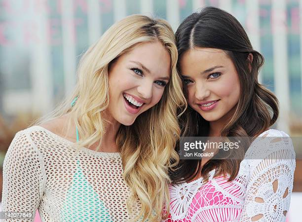 Candice Swanepoel and Miranda Kerr pose at Victoria's Secret Angels Miranda Kerr and Candice Swanepoel Launch The 2012 SWIM Collection at the...