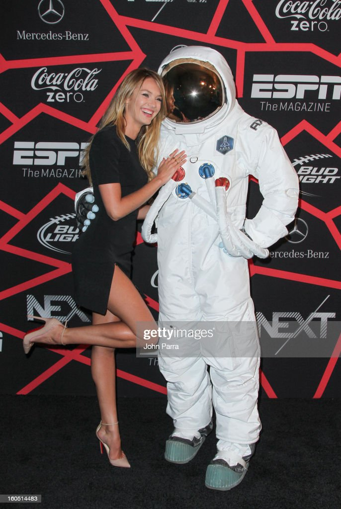 Candice Swanepoel and the AXE Astronaut attend the ESPN party on February 1, 2013 in New Orleans, Louisiana.
