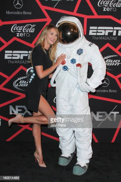 Candice Swanepoel and the AXE Astronaut attend the ESPN party on February 1 2013 in New Orleans Louisiana