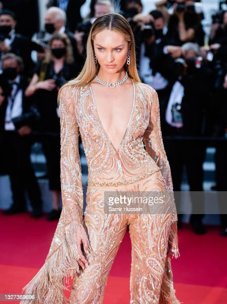 """Candice Swanepoel attends the """"Annette"""" screening and opening ceremony during the 74th annual Cannes Film Festival on July 06, 2021 in Cannes, France."""