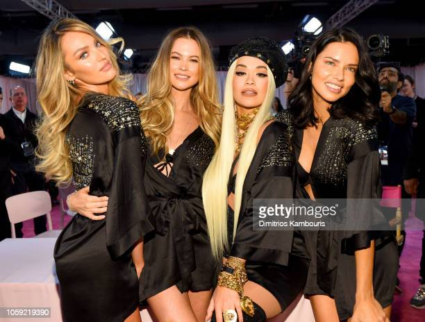 Candice Swanepoel Behati Prinsloo Rita Ora and Adriana Lima prepare backstage during 2018 Victoria's Secret Fashion Show in New York at Pier 94 on...