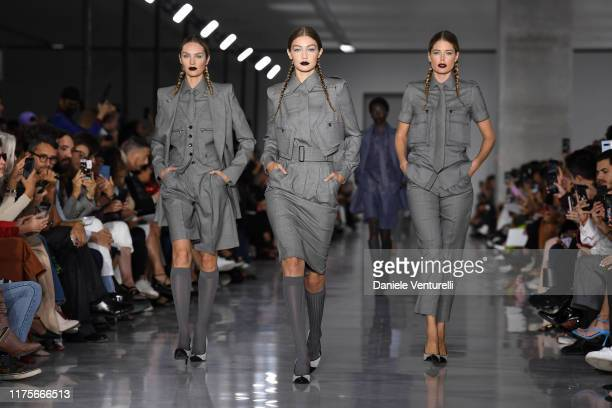 Candice Swanepoel Gigi Hadid and Doutzen Kroes walks the runway at the Max Mara show during the Milan Fashion Week Spring/Summer 2020 on September 19...