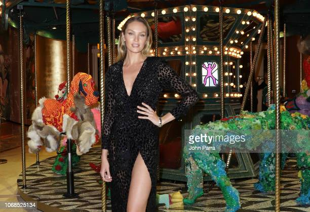 Candice Swanepoel poses infront of artwork by Raul De Nieves presented by Bvlgari Art Production Fund during Art Basel Miami Beach 2018 at Faena...
