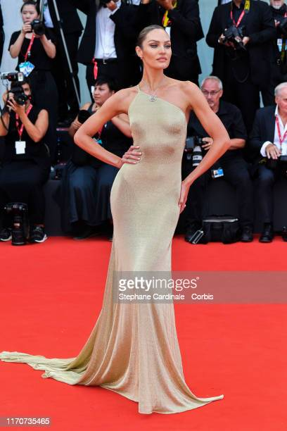 Candice Swanepoel walks the red carpet ahead of the opening ceremony during the 76th Venice Film Festival at Sala Casino on August 28 2019 in Venice...