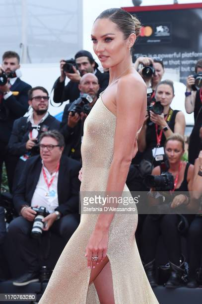 Candice Swanepoel walks the red carpet ahead of the Opening Ceremony and the La Vérité screening during the 76th Venice Film Festival at Sala Grande...