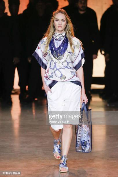 Candice Swanepoel walks the runway at the TommyNow Ready to Wear Fall/Winter 20202021 fashion show during London Fashion Week on February 16 2020 in...