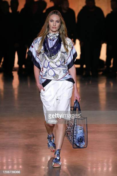 Candice Swanepoel walks the runway at the TommyNow show during London Fashion Week February 2020 at the Tate Modern on February 16 2020 in London...