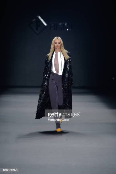 Candice Swanepoel walks the runway during Forum show at Sao Paulo Fashion Week Winter 2014 on October 30 2013 in Sao Paulo Brazil