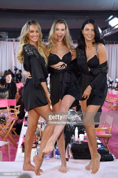 Candice Swanepoelm Josie Canseco and Adriana Lima prepare backstage during the 2018 Victoria's Secret Fashion Show in New York at Pier 94 on November...