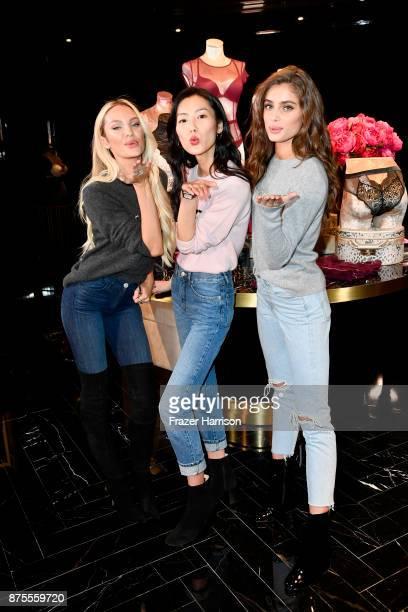 Candice Swanpoel Liu Wen and Taylor Hill pose at the Victoria's Secret Store At Lippo Plaza Appearance at Victoria's Secret on November 18 2017 in...
