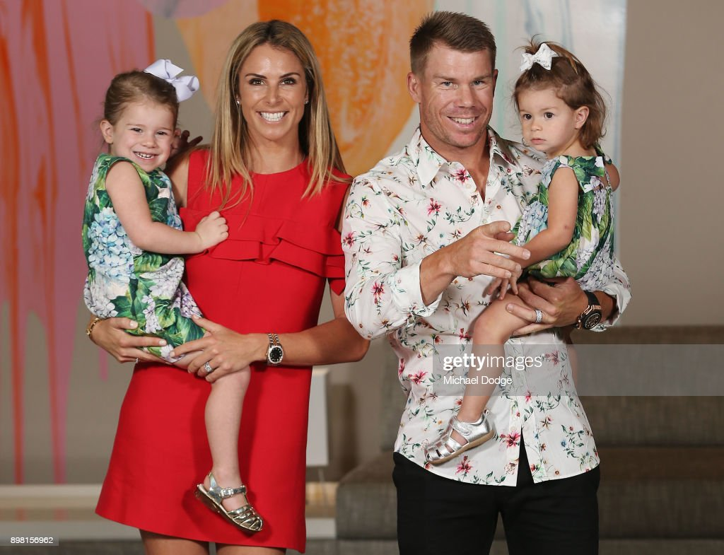 Candice Warner and David Warner pose with their daughters Ivy (L) and Indi during the Australian nets session at the on December 25, 2017 in Melbourne, Australia.