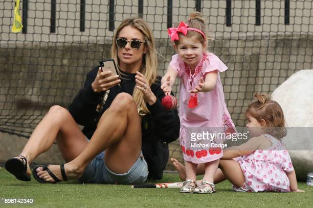 Candice Warner relaxes with their daughters Ivy and Indi during the Australian nets session at the on December 25 2017 in Melbourne Australia