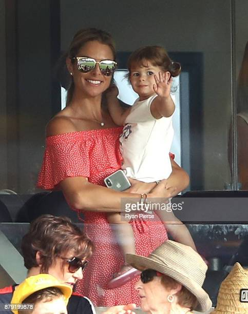 Candice Warner wife of David Warner of Australia and their daughter Indi Warner look on during day three of the First Test Match of the 2017/18 Ashes...