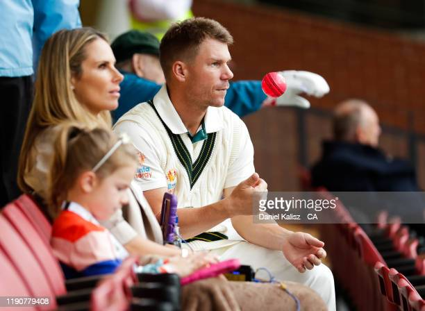 Candice Warner wife of David Warner talks with David Warner of Australia during a rain delay day one of the 2nd Domain Test between Australia and...