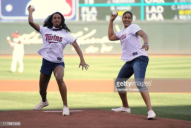 Candice Wiggins and Maya Moore of the Minnesota Lynx throw out ceremonial pitches before the game between the Minnesota Twins and the Milwaukee...
