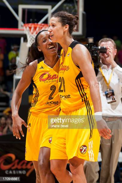 Candice Wiggins and Nicole Powell of the Tulsa Shock celebrate the team's victory over the Chicago Sky during the WNBA game on June 20 2013 at the...
