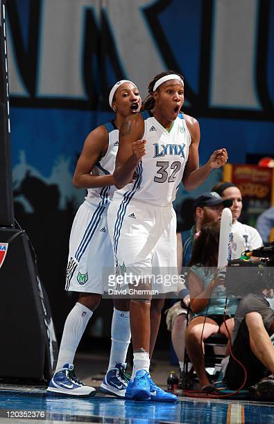 Candice Wiggins and Rebekkah Brunson of the Minnesota Lynx celebrate after the game against the San Antonio Silver Stars on August 4 2011 at Target...