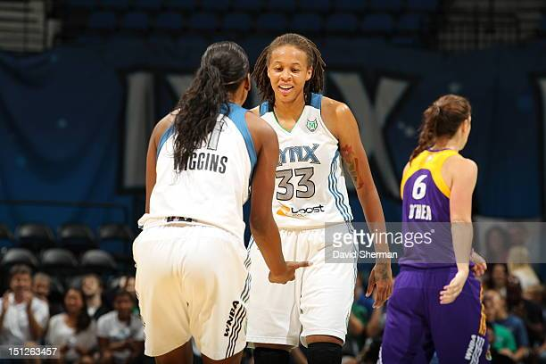 Candice Wiggins celebrates with Seimone Augustus after she set the alltime scoring record during the WNBA game against the Los Angeles Sparks on...