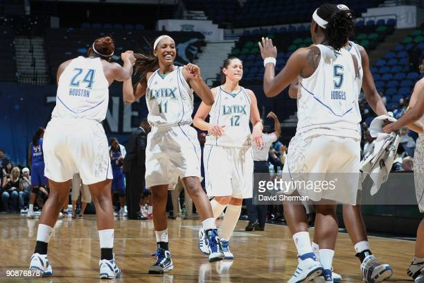 Candice Wiggins Charde Houston and Roneeka Hodges of the Minnesota Lynx celebrate during the game against the Detroit Shock on September 9 2009 at...
