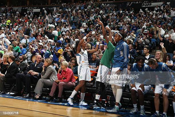 Candice Wiggins Devereaux Peters and Jessica Adair of the Minnesota Lynx celebrate from bench during the 2012 WNBA Finals Game Two against the...