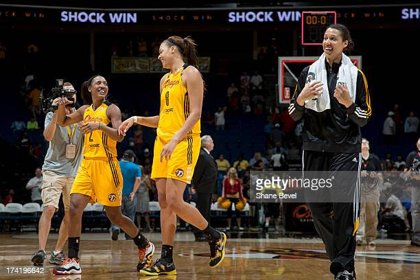Candice Wiggins Elizabeth Cambage and Nicole Powell of the Tulsa Shock celebrate after defeating the Atlanta Dream in the WNBA game on July 21 2013...