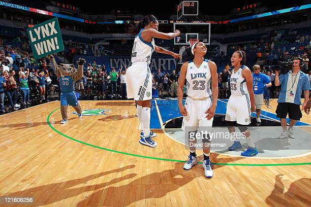 Candice Wiggins Maya Moore and Seimone Augustus of the Minnesota Lynx celebrate after clinching their spot at the playoffs after the game against the...