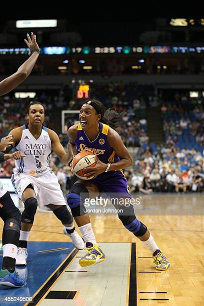 Candice Wiggins of the Los Angeles Sparks drives to the basket against Tan White of the Minnesota Lynx during the WNBA game on August 12 2014 at...