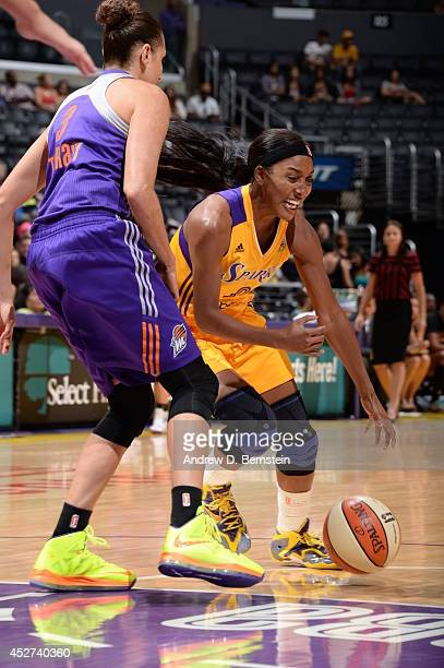 Candice Wiggins of the Los Angeles Sparks drives to the basket against the Phoenix Mercury at STAPLES Center on July 24 2014 in Los Angeles...